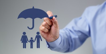 Unity Financial Solutions - Businessman hand drawing an umbrella